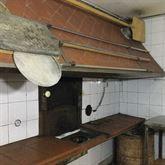 Locale adibito a forno a legna